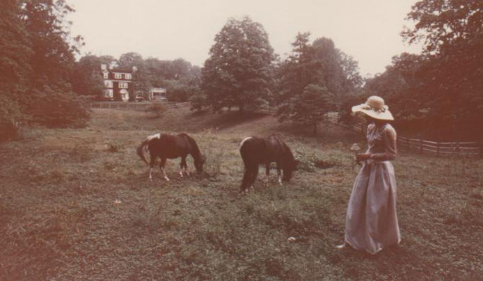 Morrene H. Jacobs with view of Wisner House, 1970s